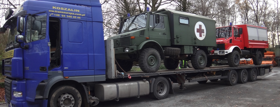 U1300L Unimogs loaded on flatbed in Europe